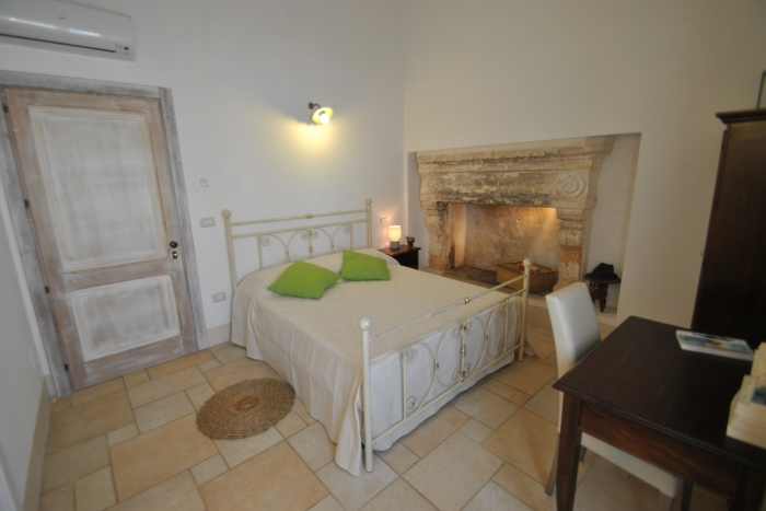 double room with ancient fireplace